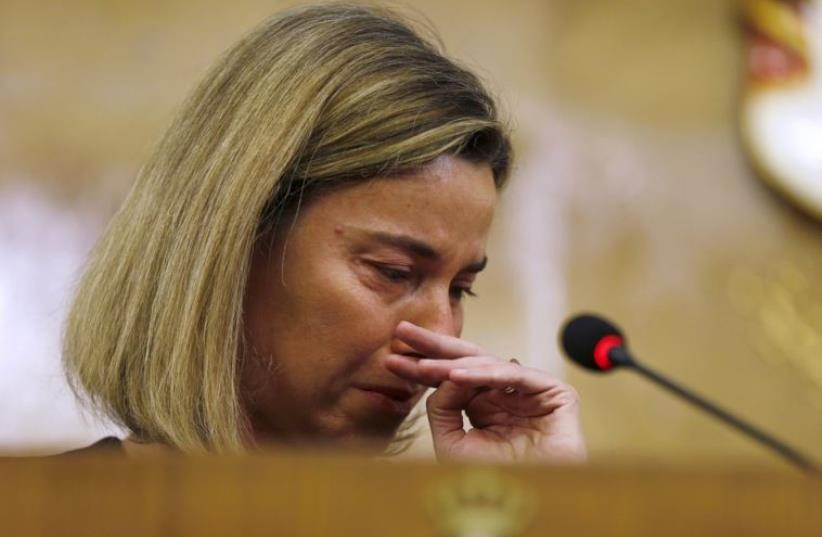 European Union foreign policy chief Federica Mogherini reacts to news of the Belgium blasts in Amman (photo credit: REUTERS)