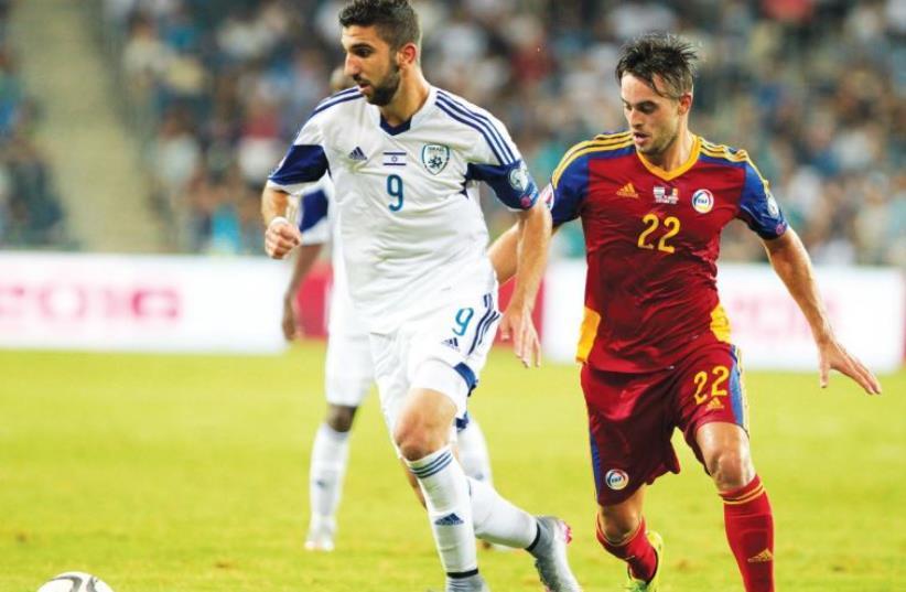 Israel striker Munas Dabbur (left) (photo credit: ERAN LUF)