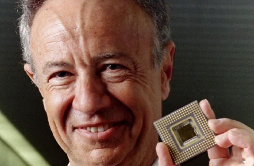 Intel Corp. President and CEO Andy Grove shows off the company's long-awaited Pentium microprocessor in March 1993.  (photo credit: REUTERS)