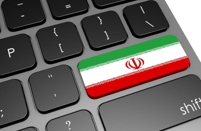 Computer keyboard with an Iranian flag [Illustrative] (photo credit: INGIMAGE)
