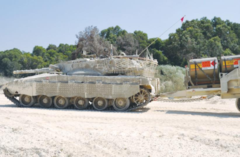 THE TWO-WHEELED BACKTRAIL (right) can carry 8 tons of supplies (photo credit: COURTESY URDAN)