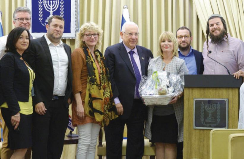 PRESIDENT REUVEN RIVLIN meets with representatives of the Lev Haolam organization, which fights the BDS movement, at his residence on Wednesday. (photo credit: GPO)