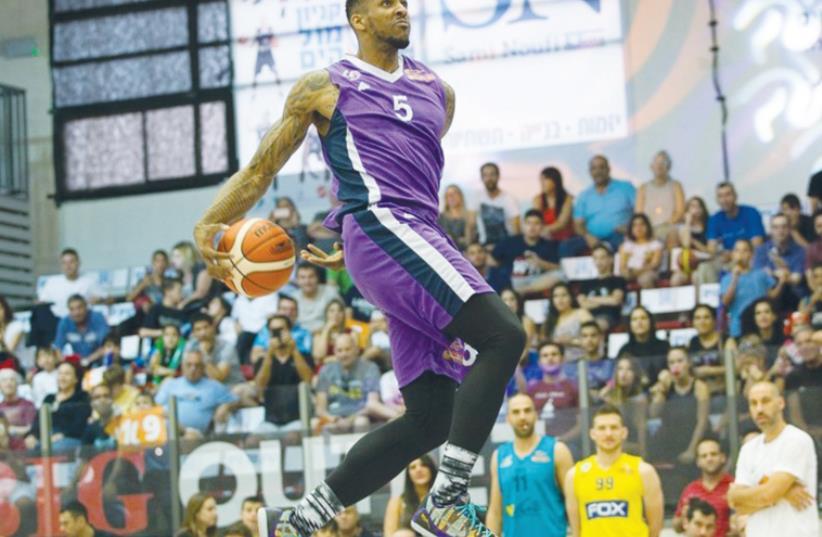 Ironi Nahariya forward Gilbert Brown won the slam dunk contest during Friday's BSL All-Star festivities in Eilat. (photo credit: ODED KARNI/BSL)