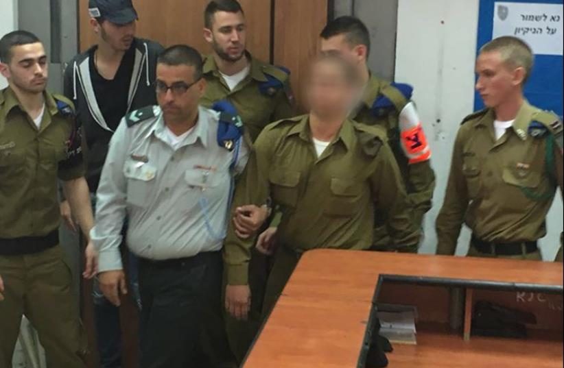 IDF soldier who shot a neutralized Palestinian terrorist in Hebron being led into court, March 29, 2016 (photo credit: NOAM AMIR)