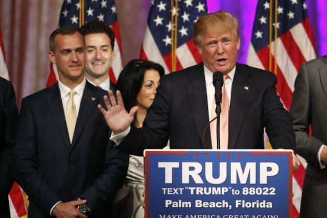 Republican US presidential candidate Donald Trump speaks with his campaign manager Corey Lewandowski (L) at his side as he talks about the results of the Florida, Ohio, North Carolina, Illinois and Missouri primary elections (photo credit: REUTERS)