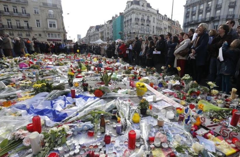 People gather at a street memorial in Brussels following Tuesday's bombings in Brussels (photo credit: REUTERS)