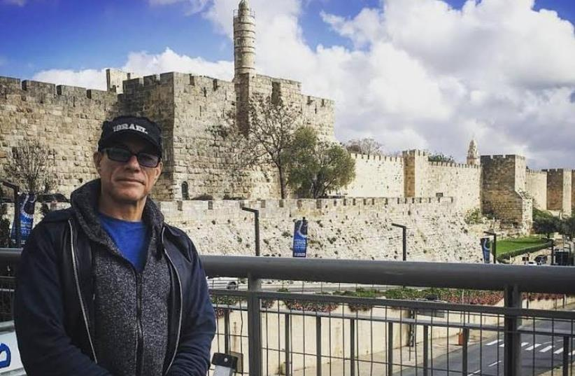 Jean-Claude Van Damm poses in front of the Old City (photo credit: FACEBOOK)