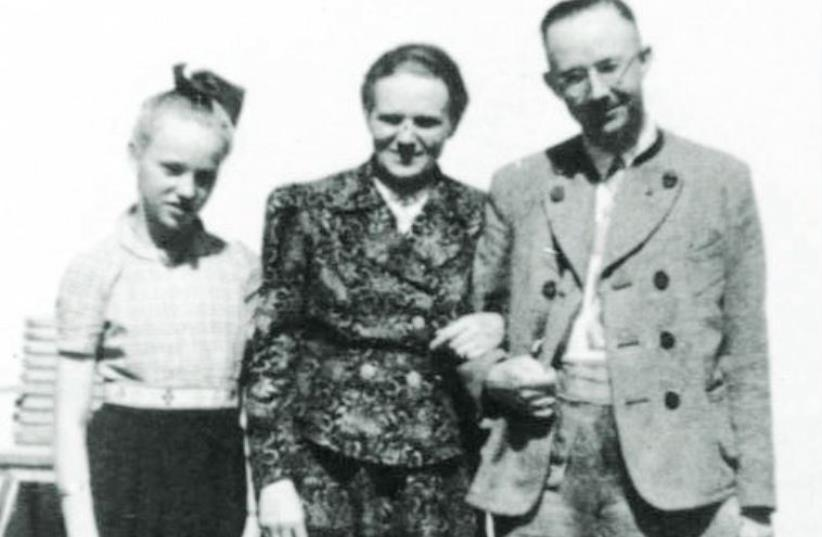 HEINRICH HIMMLER poses for a photo with his wife Marga and his daughter Gudrun. (photo credit: Wikimedia Commons)
