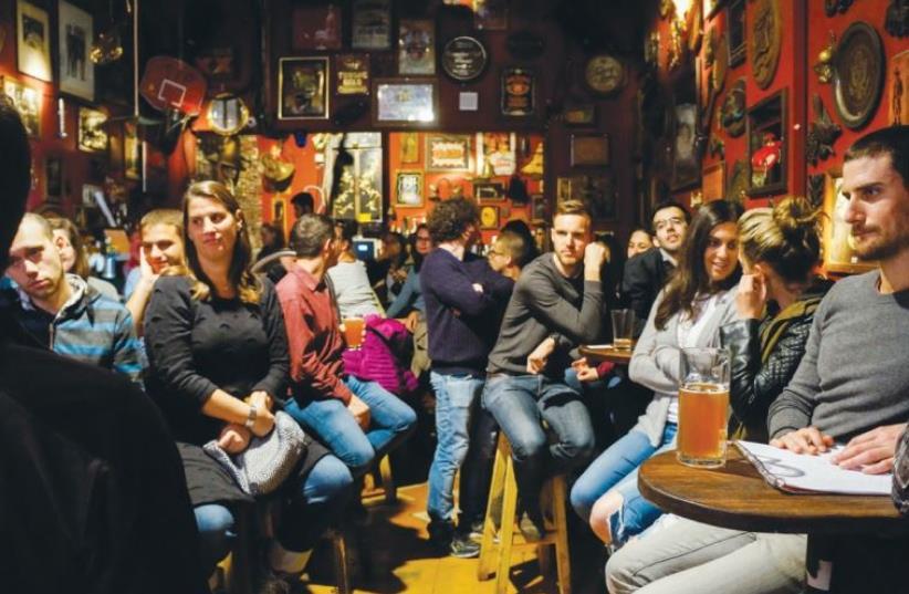 THE TEL AVIR group meets at Joey's Bar in Tel Aviv on Tuesday night. (photo credit: DAVID BEER-GABEL)