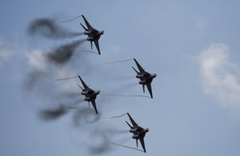MiG-29 jet fighters of the Russian aerobatic team Strizhi (The Swifts) perform during the MAKS International Aviation and Space Salon in Zhukovsky outside Moscow, Russia, August 30, 2015 (photo credit: REUTERS)