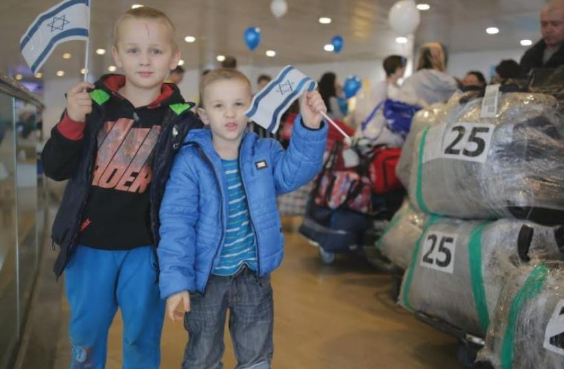 New immigrants from Ukraine pose for a picture after arriving in Israel last month (photo credit: DANIEL BAR-ON)