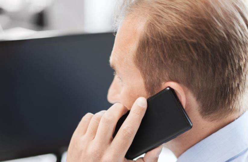 Man on Phone (photo credit: INGIMAGE)