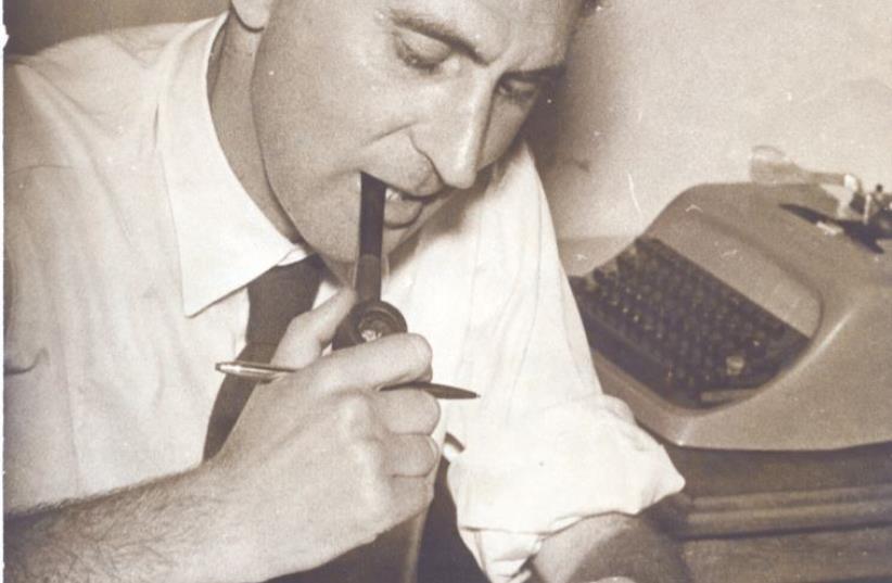 JOE BLUMBERG at his desk at 'Drum' magazine, Johannesburg. (photo credit: COURTESY THE BLUMBERG FAMILY)