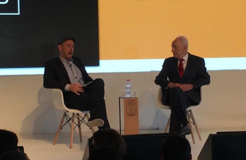 Shimon Peres with Forbes editor Randall Lane. (photo credit: NIV ELIS)