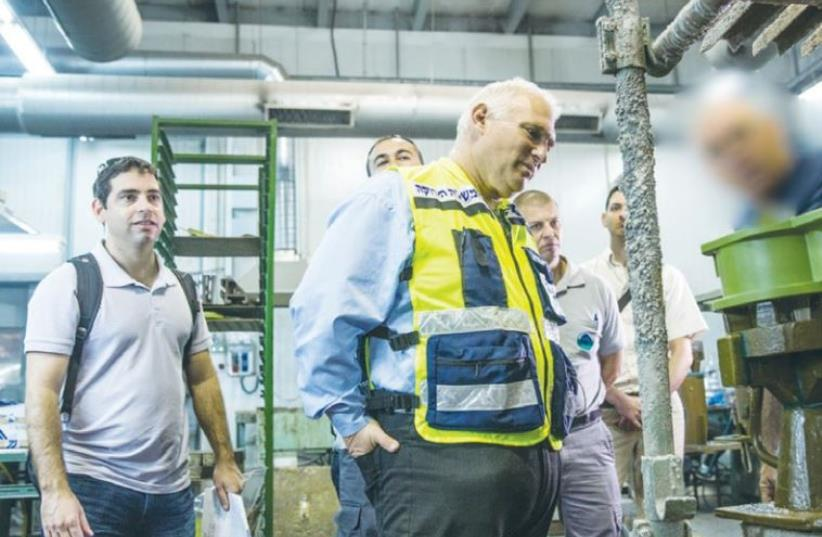 INSPECTORS EXAMINE a factory in the Haifa Bay area. (photo credit: ENVIRONMENT PROTECTION MINISTRY)