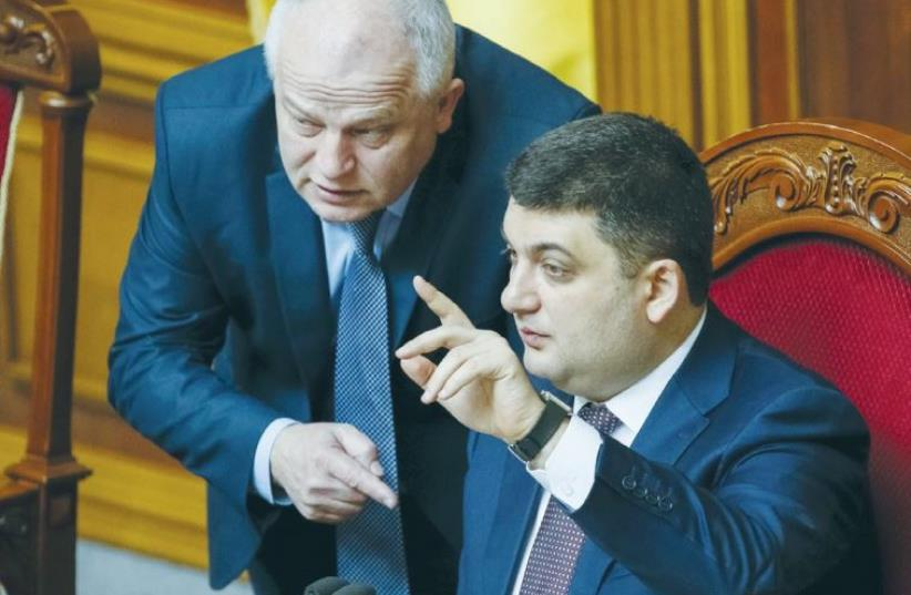UKRAINIAN PARLIAMENT SPEAKER Volodmyr Groysman (right) speaks with Stepan Kubiv, President Petro Poroshenko's representative in parliament, during a session in Kiev on March 29. (photo credit: GLEB GARANICH/REUTERS)