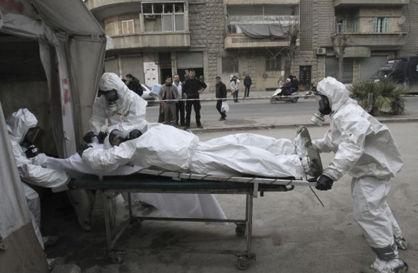 Syrian opposition group carries out chemical weapons drill (illustrative) (photo credit: REUTERS)