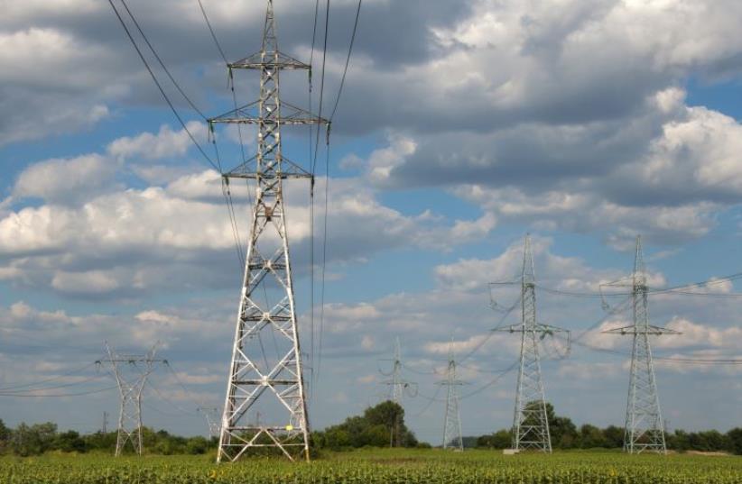 Electric poles (illustrative). (photo credit: INGIMAGE)