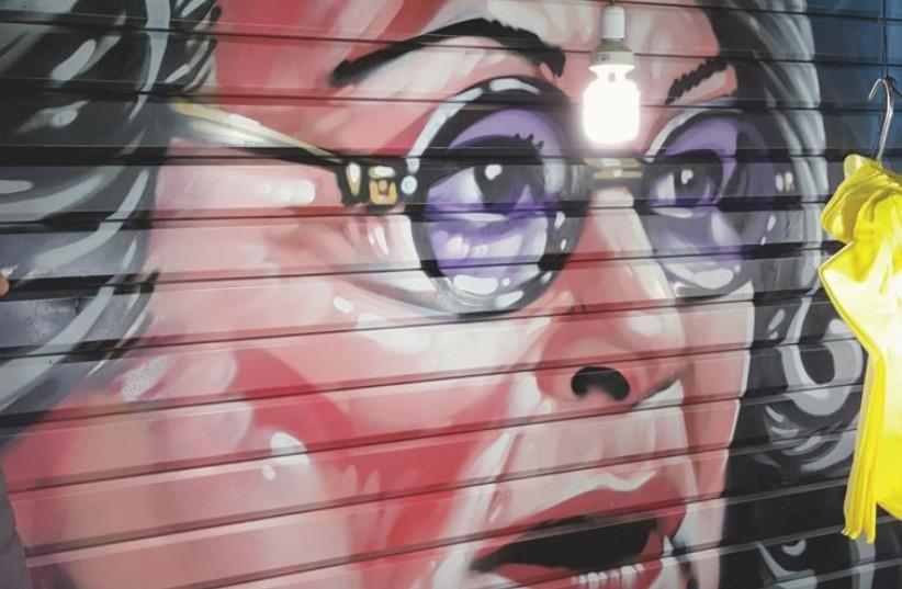 Graffiti Portrait of Roseanne in Jerusalem's Mahane Yehuda market by Painter Solomon Souza (photo credit: FMHT STUDIOS)