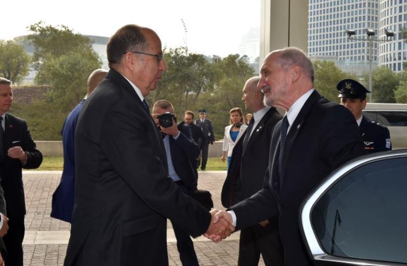 Defense Minister Moshe Ya'alon meets his Polish counterpart,  Antoni Macierewicz, in Tel Aviv on Wednesday. (photo credit: ARIEL HERMONI / DEFENSE MINISTRY)