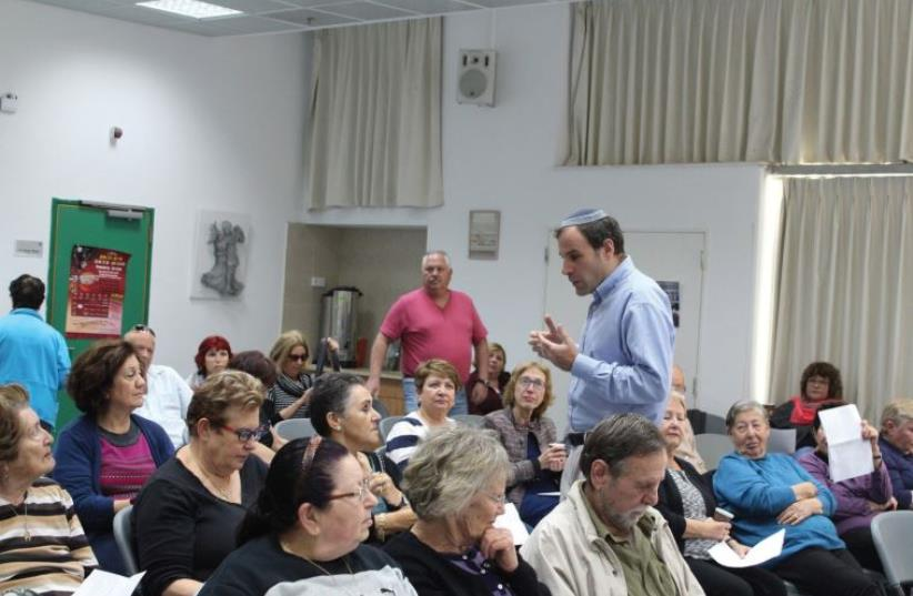 THE AUTHOR lecturing to members of a kibbutz in Israel. (photo credit: Courtesy)