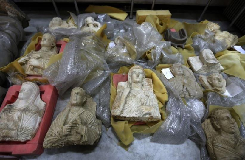 Antiquities are unwrapped as thousands of priceless antiques from across war-ravaged Syria are gathered in the capital to be stored safely away from the hands of ISIS, in Damascus, Syria August 18, 2015.   (photo credit: REUTERS)