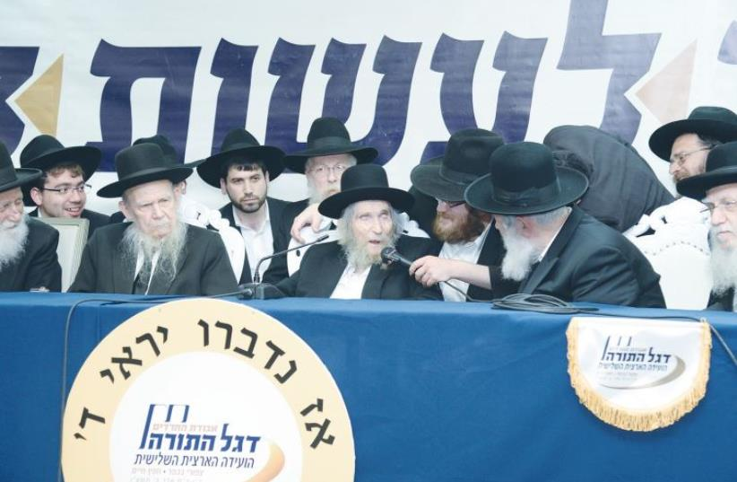 RABBI AHARON LEIB SHTEINMAN, 103, Degel Hatorah's spiritual leader, speaks at Kibbutz Hafetz Haim on Thursday, as Rabbi Gershon Edelstein (second left), 93, and others listen. (photo credit: JEREMY SHARON)