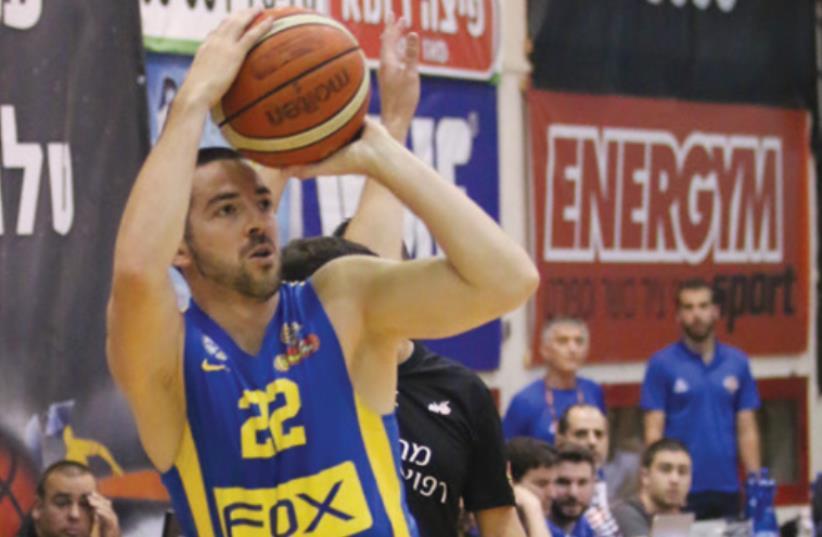 Maccabi Tel Aviv guard Taylor Rochestie scored a game-high 24 points in last night's 90-80 win at Bnei Herzliya. (photo credit: ADI AVISHAI)