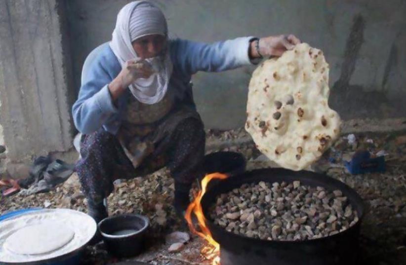 A WOMAN MAKES traditional pita bread in Kafr Kasim, near Rosh Ha'ayin (photo credit: Courtesy)