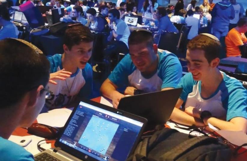 HIGH SCHOOL pupils compete in the finals of the National Cyber Conference in Tel Aviv, April 12, 2016 (photo credit: (AICF/CHRIS LEE))