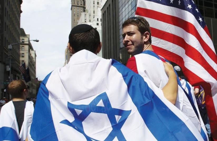People take part in the 51st annual Israel parade in New York City last year (photo credit: REUTERS)