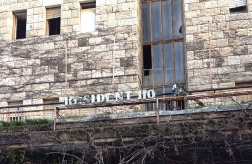 The site of the former President Hotel on Ahad Ha'am Street. In a comic twist, the derelict sign now reads 'Resident Ho.' (photo credit: ERICA SCHACHNE)