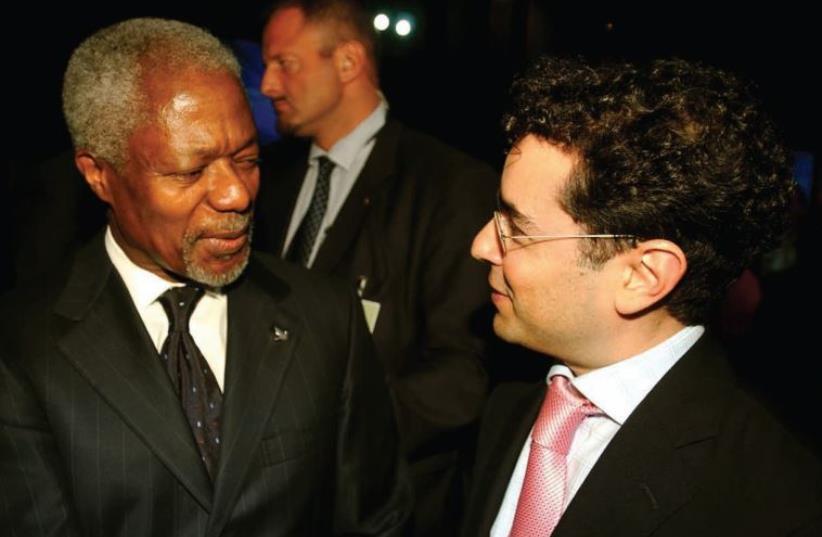 Hillel Neuer with Kofi Annan, UN secretary-general from 1997 to 2006. (photo credit: Courtesy)