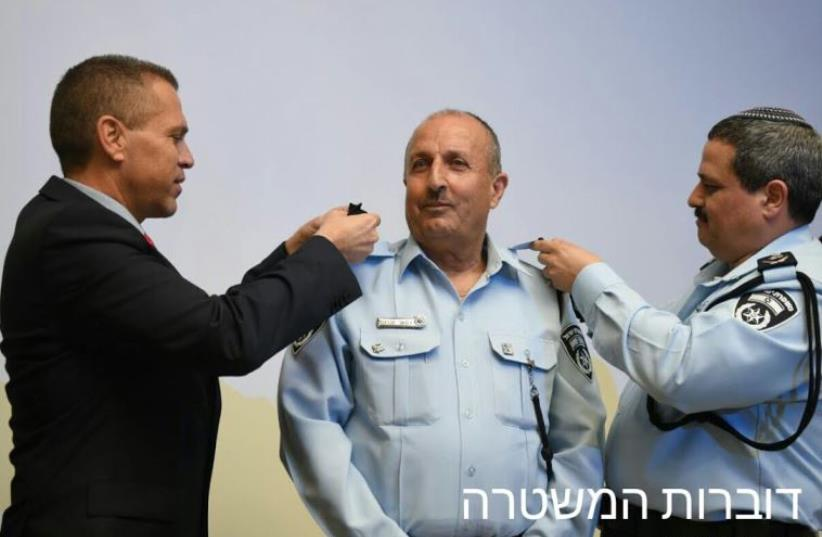 Gilad Erdan (left), Jamal Hachrush (center), and  Roni Alsheich (photo credit: POLICE SPOKESPERSON'S UNIT)