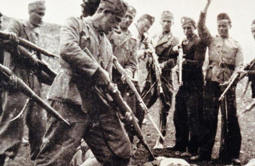 VICTIMS OF the Nazi-backed Ustasha regime killed at the end of the World War Two lay on the ground surrounded by posing Ustasha soldiers near the Sava river in Croatia in 1945. (photo credit: REUTERS)