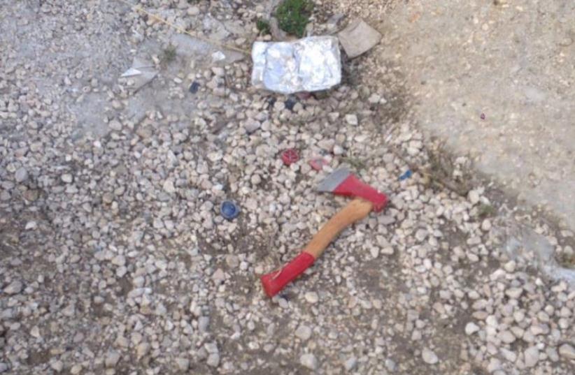 Axe of Palestinian attacker (photo credit: IDF SPOKESMAN'S UNIT)