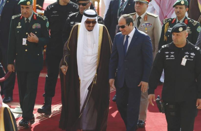 SAUDI KING Salman bin Abdulaziz, left, walks with Egypt's President Abdel Fattah al-Sisi in Riyadh last year. (photo credit: REUTERS/FAISAL AL NASSER)