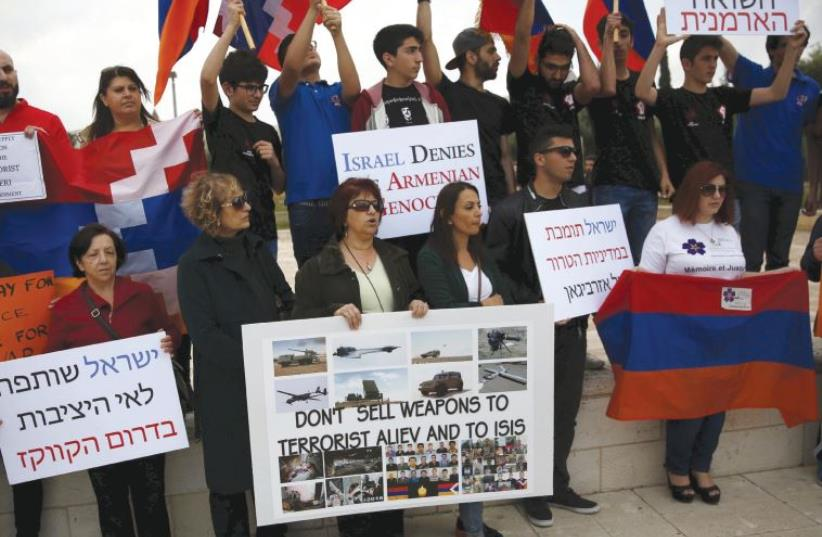 MEMBERS OF Israel's Armenian community protest against the selling of Israeli weapons to Azerbaijan outside the foreign ministry in Jerusalem yesterday. (photo credit: RONEN ZVULUN/REUTERS)