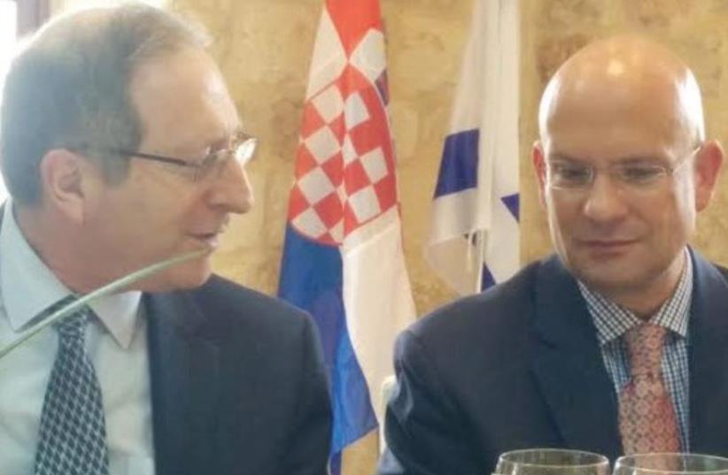 THE FOREIGN MINISTRY'S Aviv Shiran (left) with outgoing Croatian Ambassador Pjer Simunovic. (photo credit: MERON REUBEN)