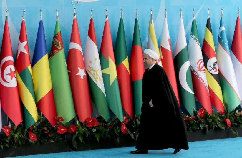 Iranian President Hassan Rouhani arrives the Organisation of Islamic Cooperation (OIC) Istanbul Summit, April 14, 2016 (photo credit: REUTERS)