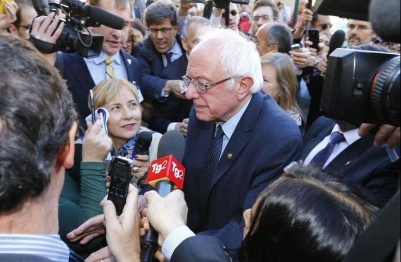 US Democratic presidential candidate Bernie Sanders speaks with media and supporters during his visit to the Vatican , April 15, 2016.  (photo credit: REUTERS)