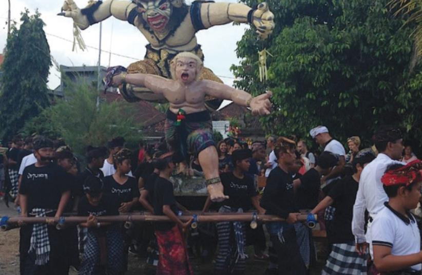 OGOH-OGOH, a towering effigy of demons and evil spirits, is carried down the street in Uluwatu. (photo credit: JANE MEDVED)