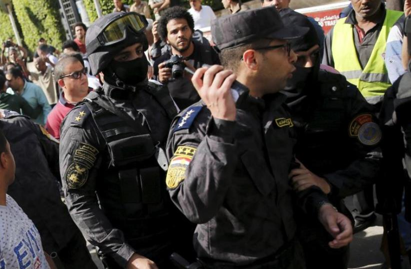 Egyptian protesters shout slogans and argue with police during a demonstration  (photo credit: REUTERS)