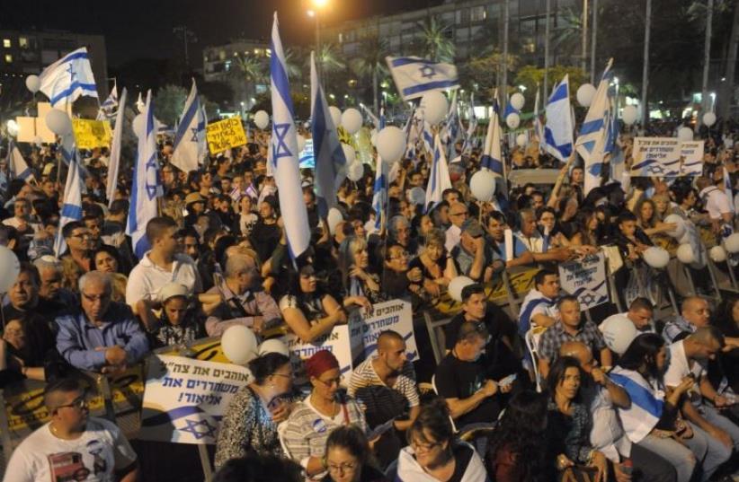 Rally in support of IDF shooter at Tel Aviv's Rabin Square (photo credit: AVSHALOM SASSONI)