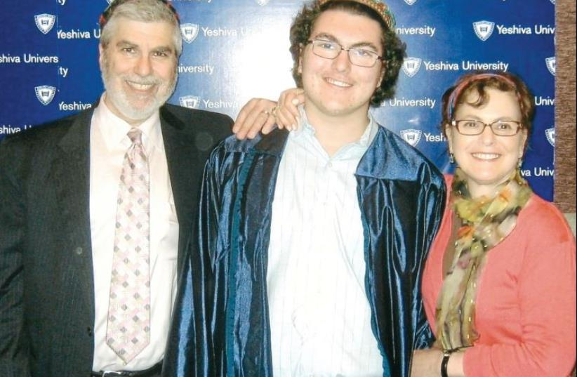 Mark and Ellen Newman with Ariel at his high-school graduation, a few months before his death (photo credit: Courtesy)