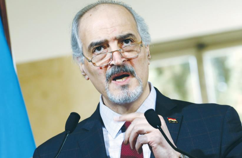 SYRIAN DELEGATION HEAD Bashar al-Ja'afari addresses a press conference following a meeting on Syria at the UN in Geneva yesterday (photo credit: REUTERS)