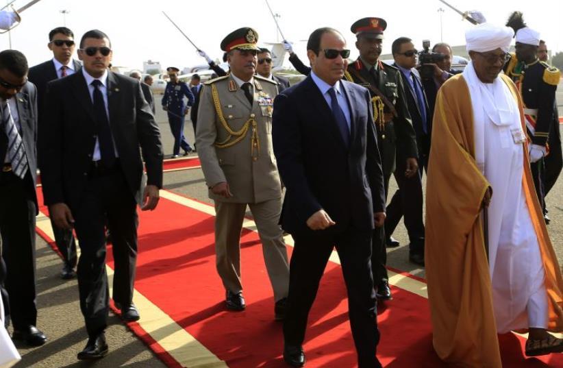 Sudan's President Bashir welcomes Egypt's President Sisi in Khartoum (photo credit: REUTERS)