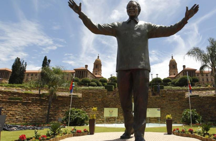 A bronze statue of the late former South African President Nelson Mandela, Pretoria (photo credit: REUTERS)