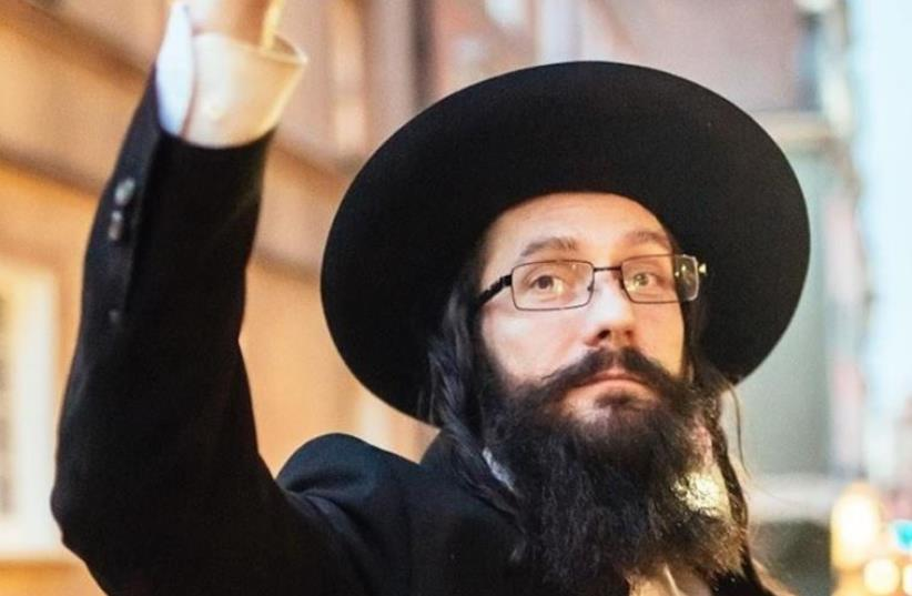 The man posing as Rabbi Jacoob Ben Nistell, from Haifa, Israel, is found to actuallky be Jacek Niszczota from Poland (photo credit: FACEBOOK)