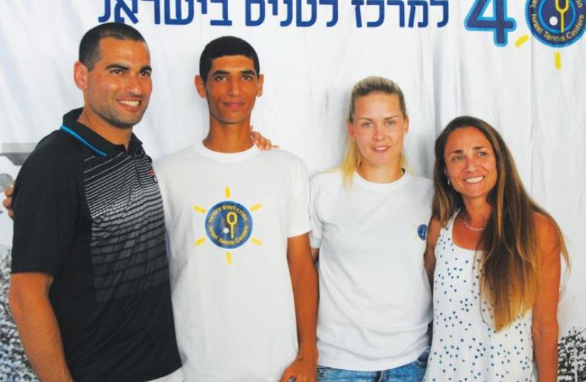 A pair of 19-year-olds – and Ram Kapach (second left) and Alona Pushkarevsky (second right) pictured with former players Anna Smashnova and Andy Ram (photo credit: Courtesy)